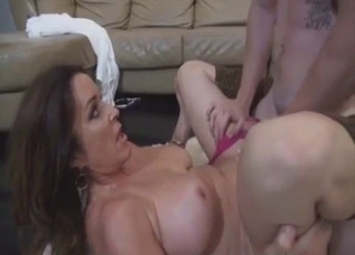 Tanned mommy happily blows him