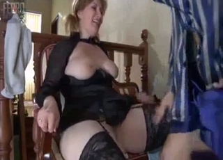 Pigtailed mommy in stockings gets fingered