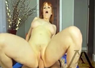 Big-breasted redhead rides that big dick