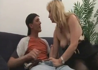 Brunette happily blows her hung son