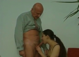 Brunette sucking her dad's cock eagerly