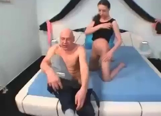 Brunette in black fucks her dad