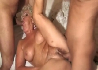 Tanned GILF spit-roasted brutally