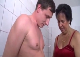 Tanned chick blows her son in the bathroom