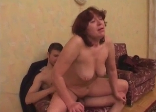 Sad-looking mommy fucks her beefy son