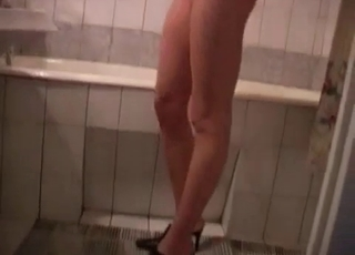 Young girl showering in front of him