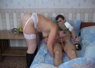 Drunk MILF sucking her son's big boner