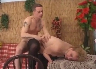 Doggy style banging for a leathery MILF