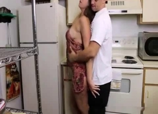 Big-breasted babe enjoys incest in the kitchen
