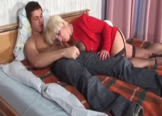 Big-breasted blonde blows her boy