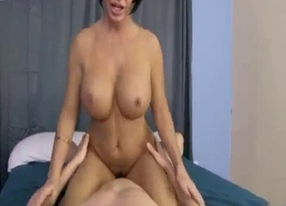 Mannish MILF rides her sons' cock