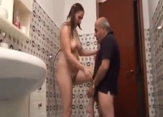 Brunette blowing her big-dicked daddy