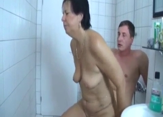 Big booty MILF rides her son's cock