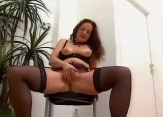 MILF in red jerking her son's cock